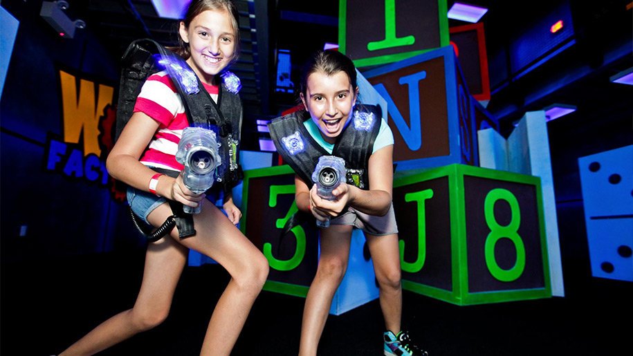 girls holding laser guns