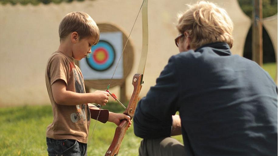boy doing archery