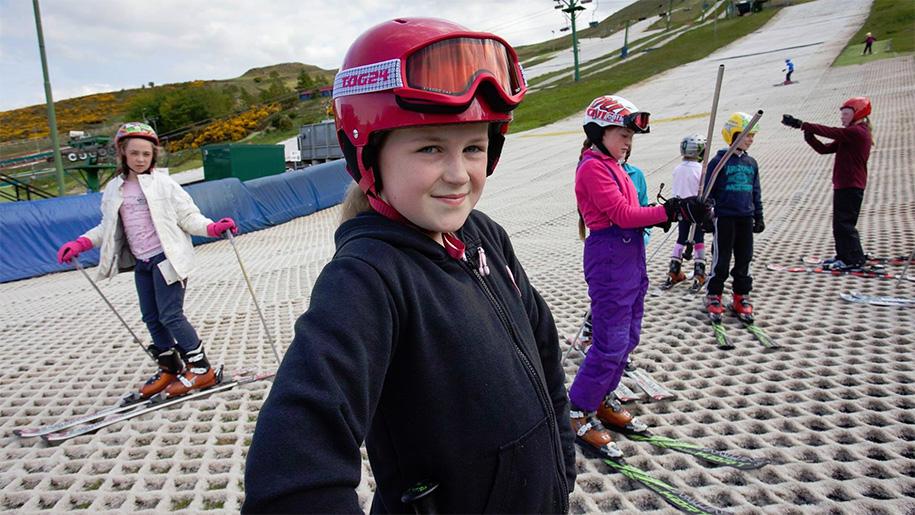 girl smiling on dry ski slope