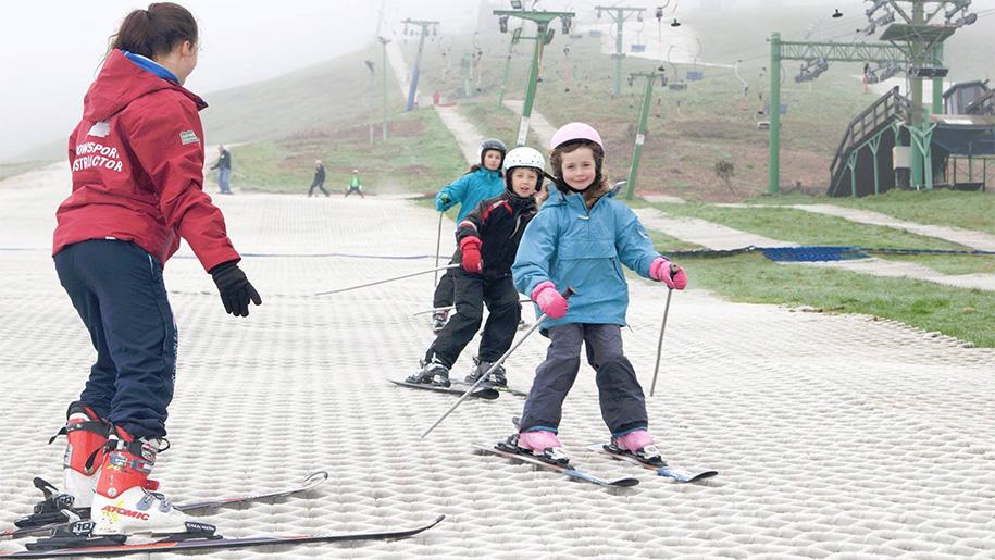 children on dry ski slope
