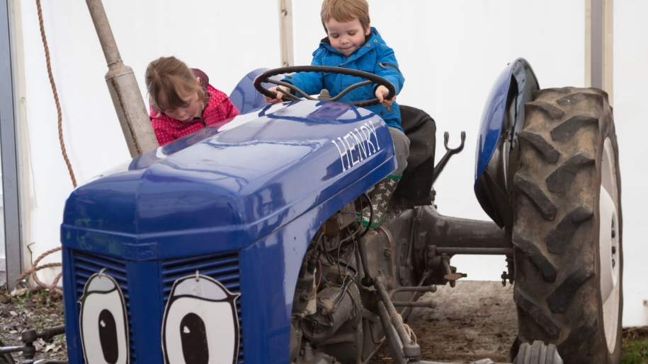 children playing on tractor