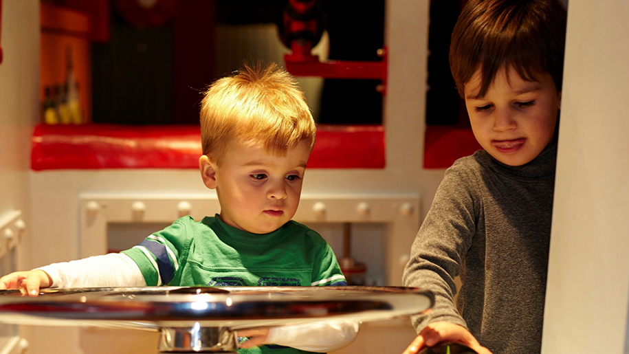 children looking at exhibit