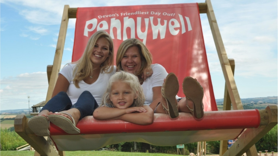 family siting on large deckchair