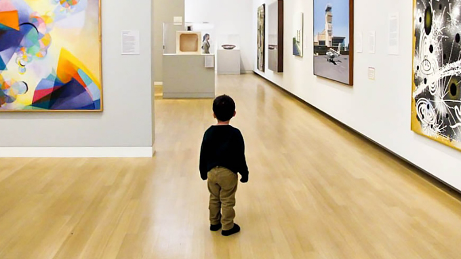 little boy in art gallery