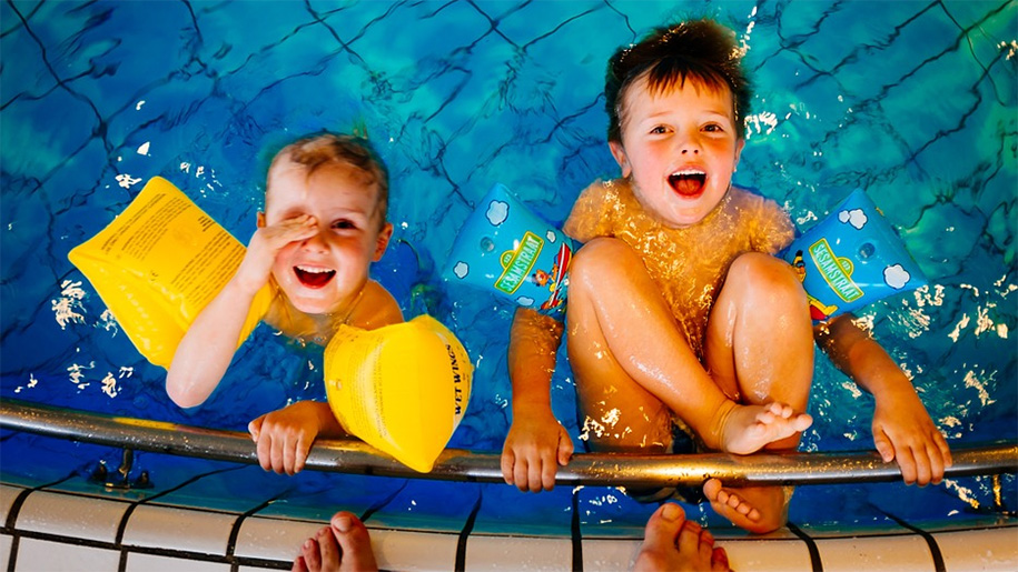 boys playing in swimming pool