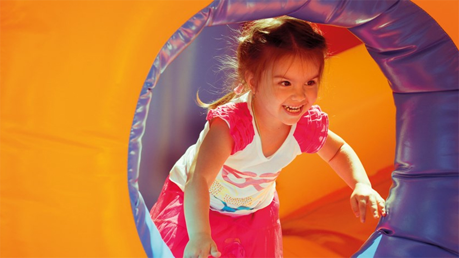 girl in inflatable tunnel