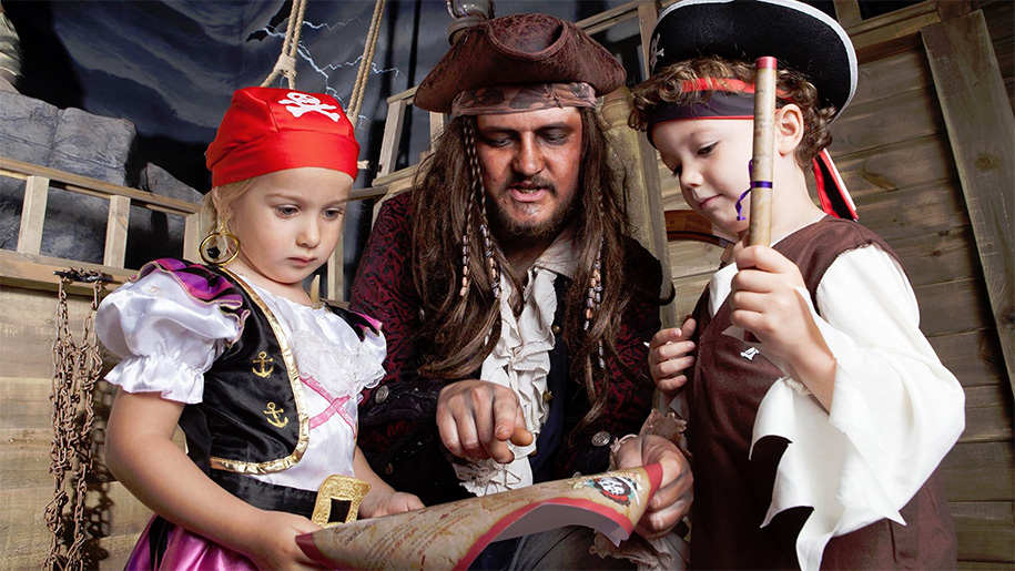 pirate with children dressed as pirates