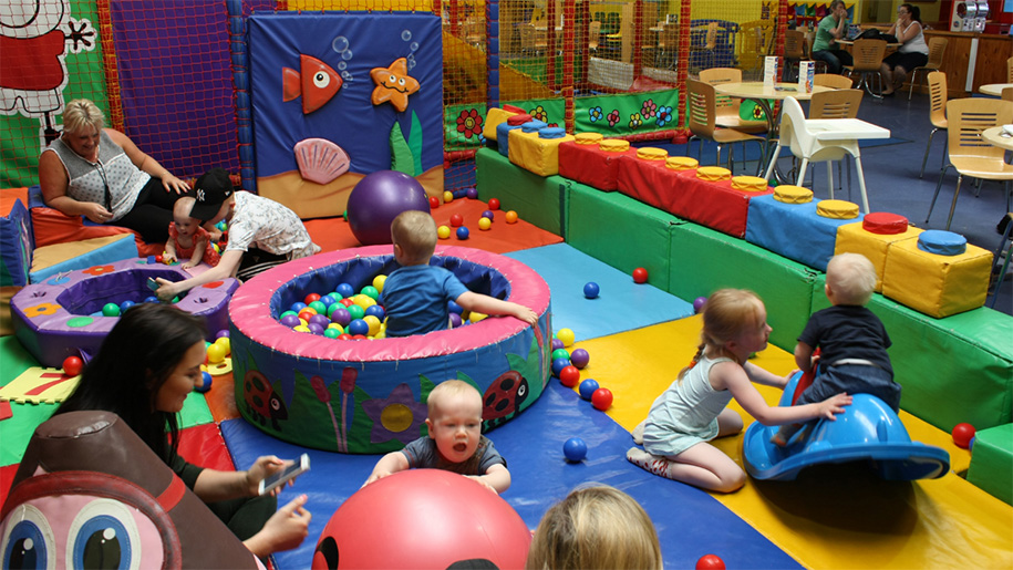 children playing in soft play area