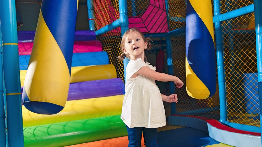 girl in soft play area