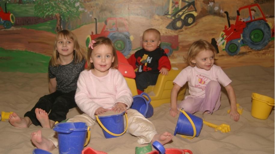 children in sand pit