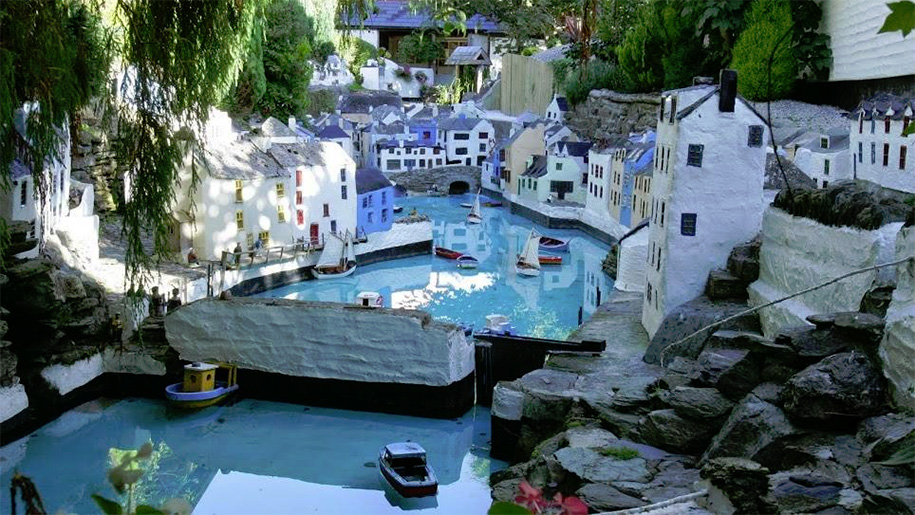 river running through miniature village