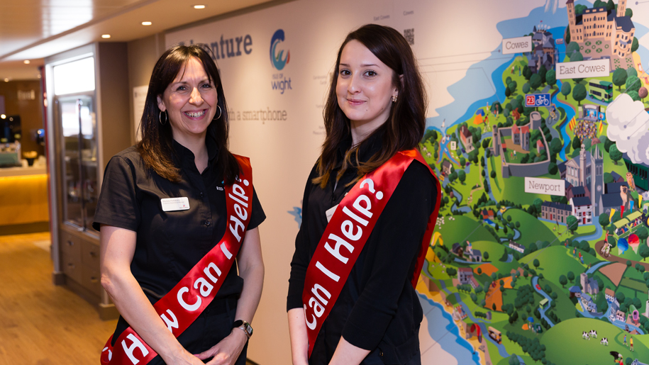 two women with can i help sashes