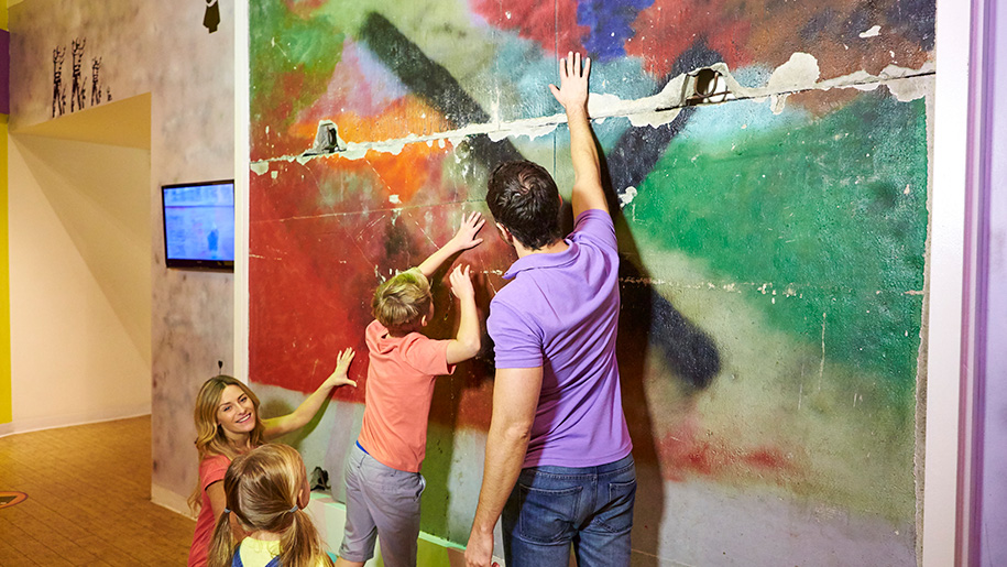 Ripley's Believe It or Not! London father and kids look at painting