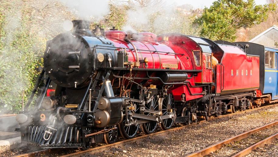 Romney, Hythe, Dymchurch railway red steam train
