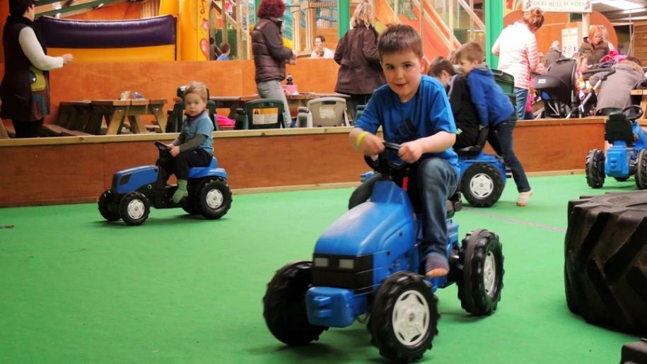 kids on tractors indoors
