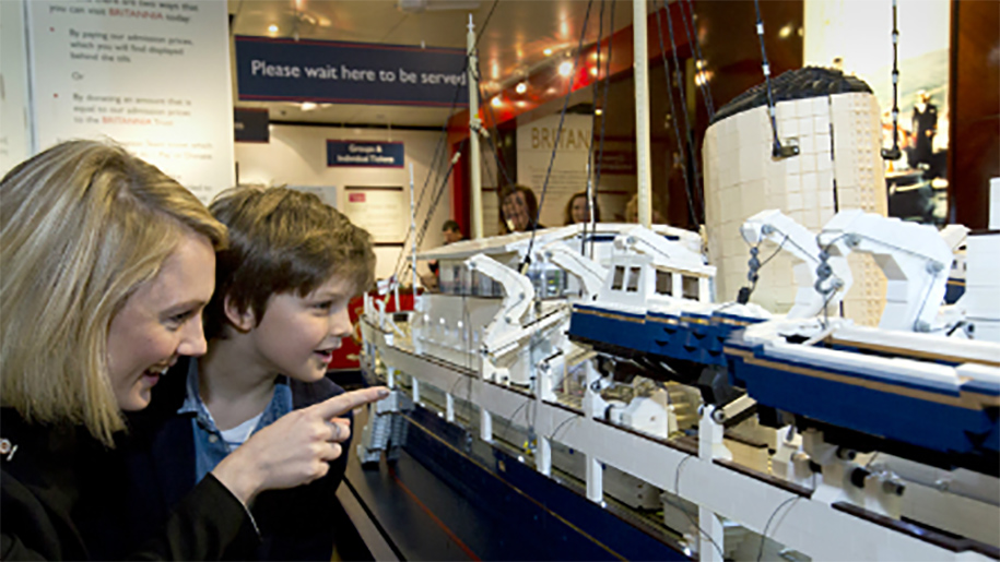 little boy looking at model ship