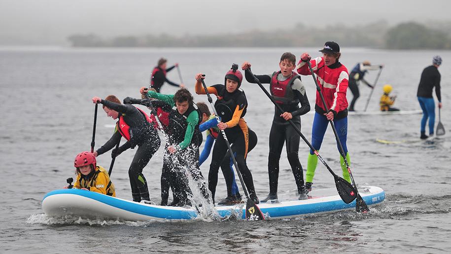 children paddleboarding