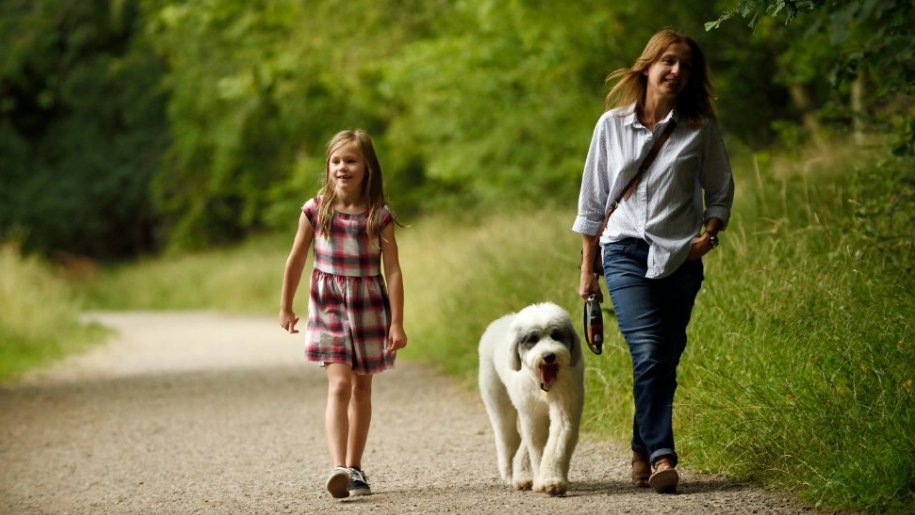 mother and daughter dog walking