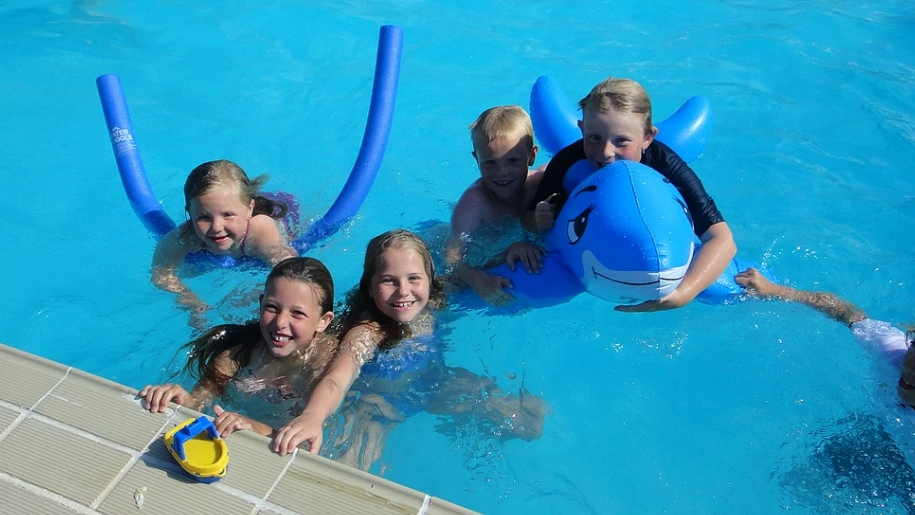 children in outdoor pool