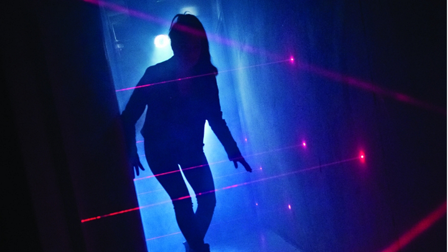 silhouette of girl with lasers
