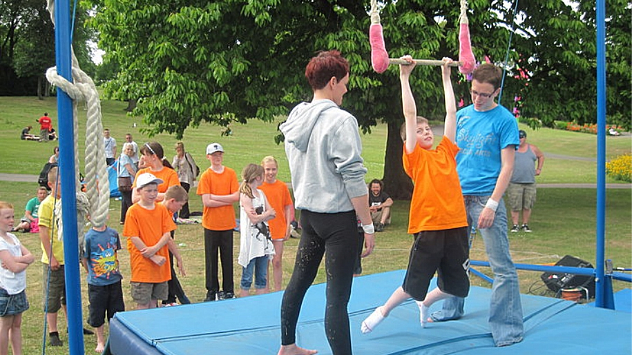 children learning circus tricks