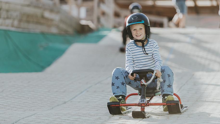 kids on dry slope skiing