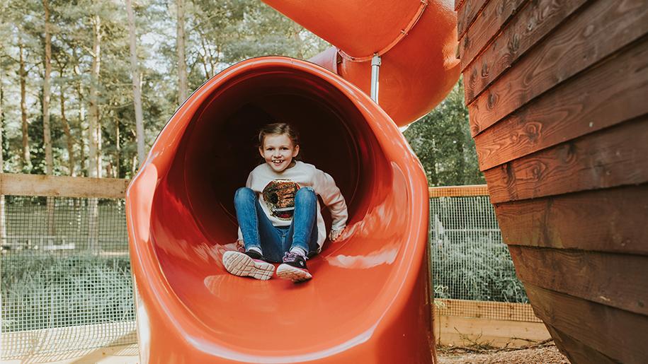 girl coming down slide