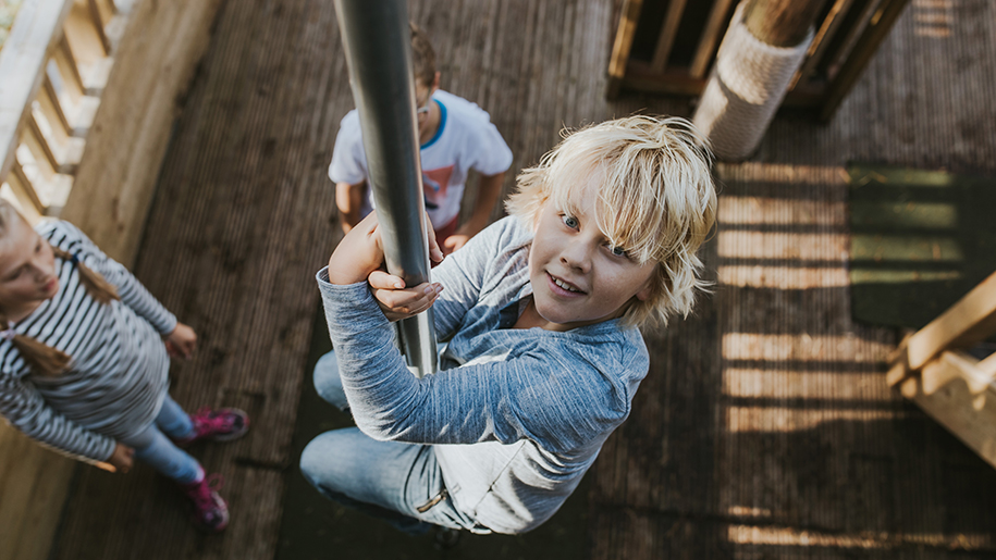 children slide down pole