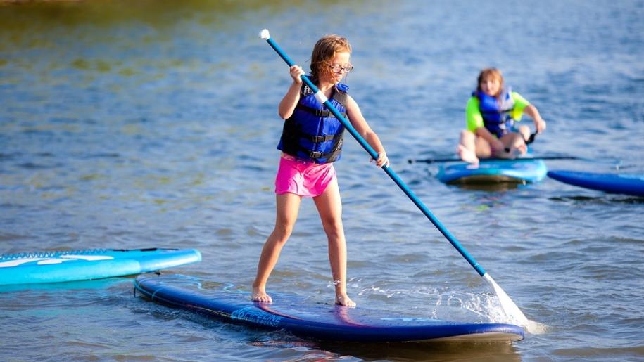 girls paddle boarding