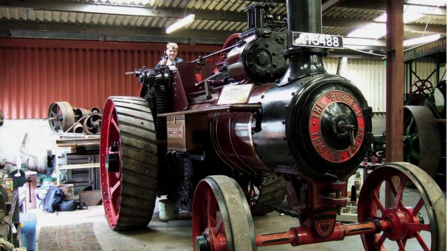 boy on steam machinery