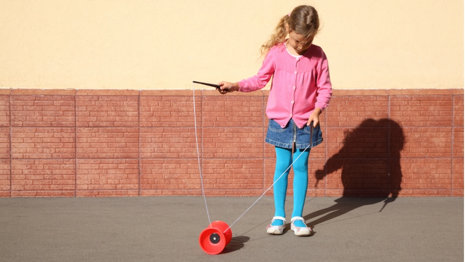 girl learning how to use a diabolo