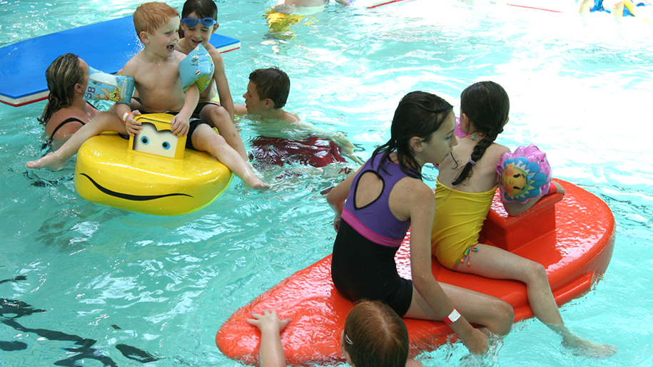 Tandridge Trust kids in swimming pool with floats