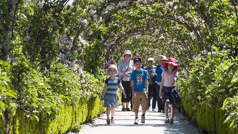 children walking through garden path