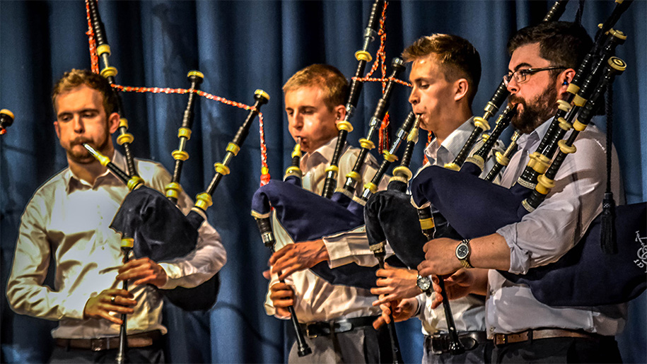 men playing the bagpipes