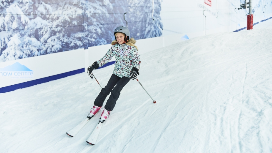 girl skiing indoors at The Snow Centre