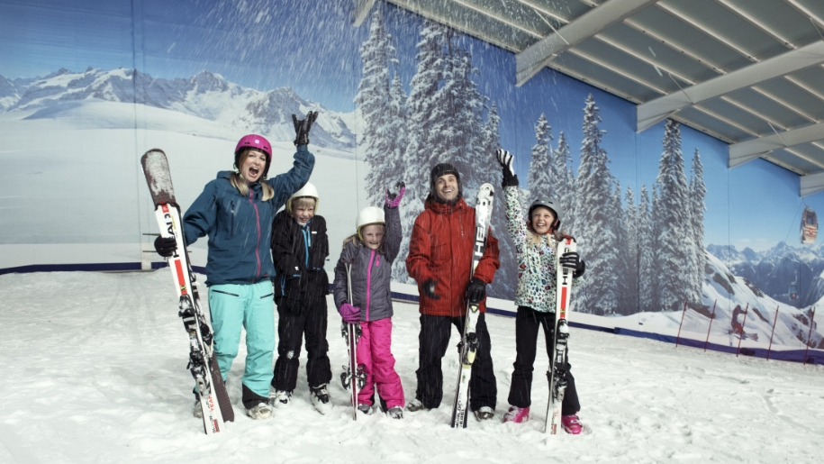 Family at indoor ski slope