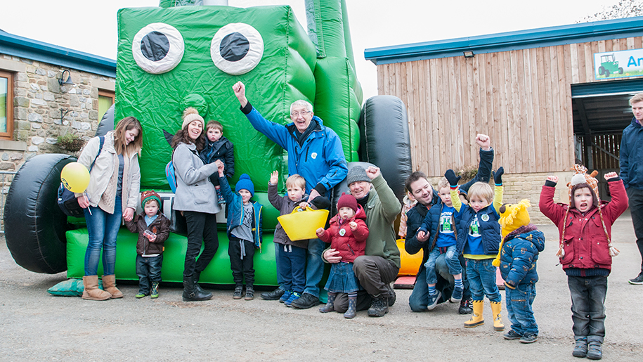 Thornton Hall children with blow up tractor