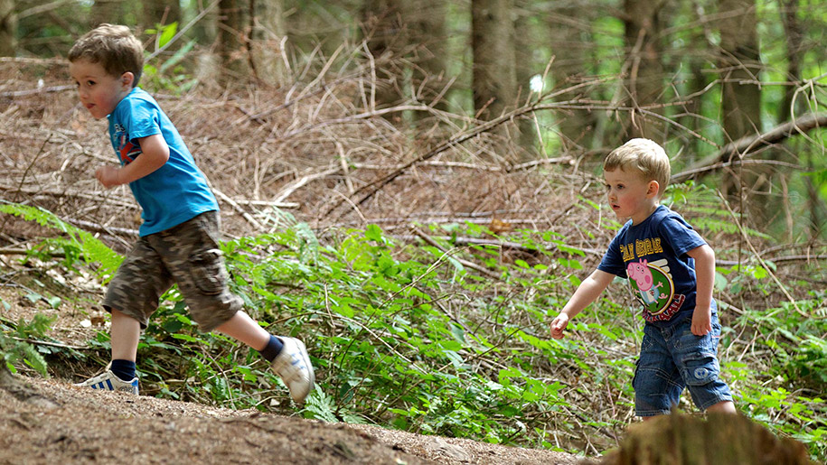 boys running through woods