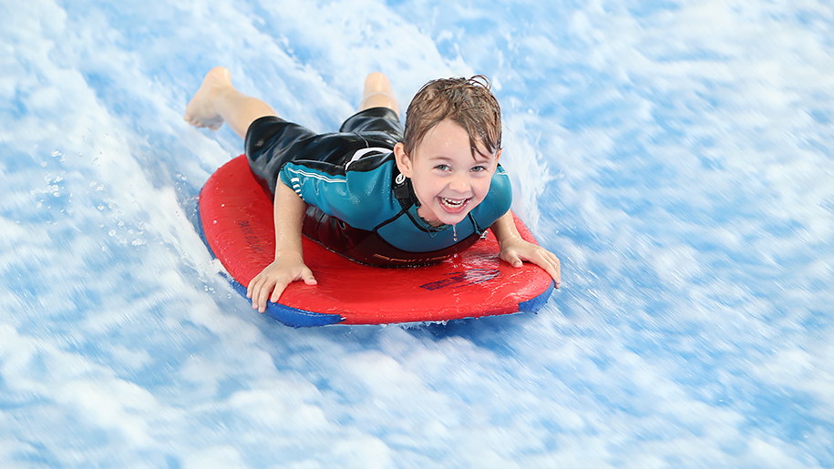 Twinwoods Adventure child on surf experience