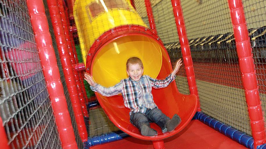 Twinwoods Adventure child on slide
