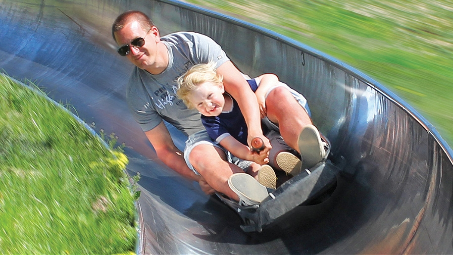 father and son on slide