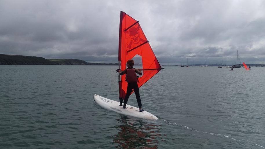 boy wind surfing
