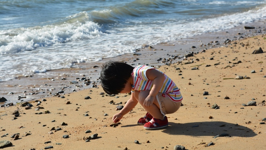 child playing on beach