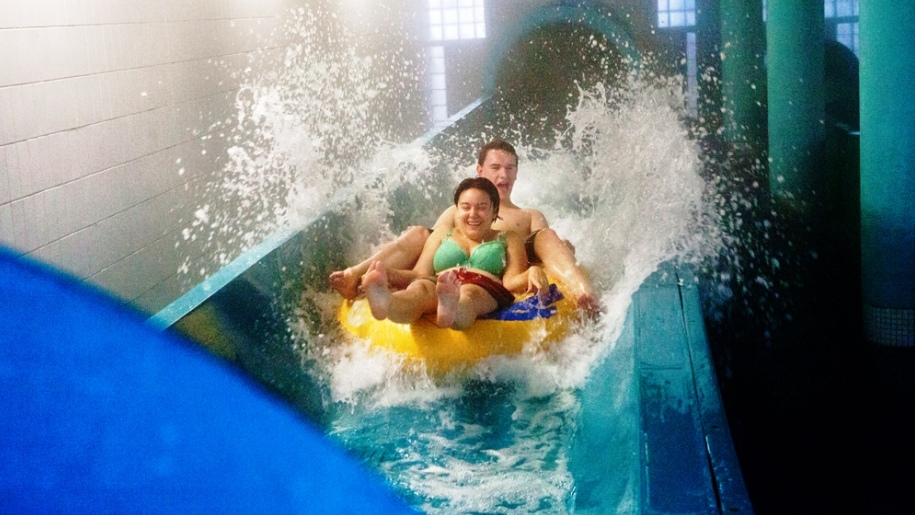 adults on water slide