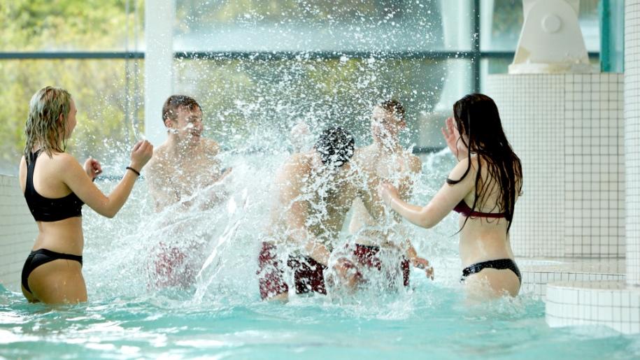 teenagers playing in pool