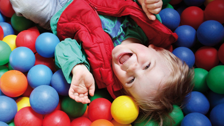 boy in ball pool
