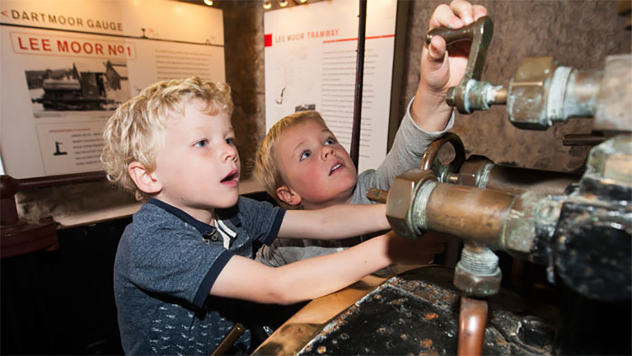 boys looking at exhibit