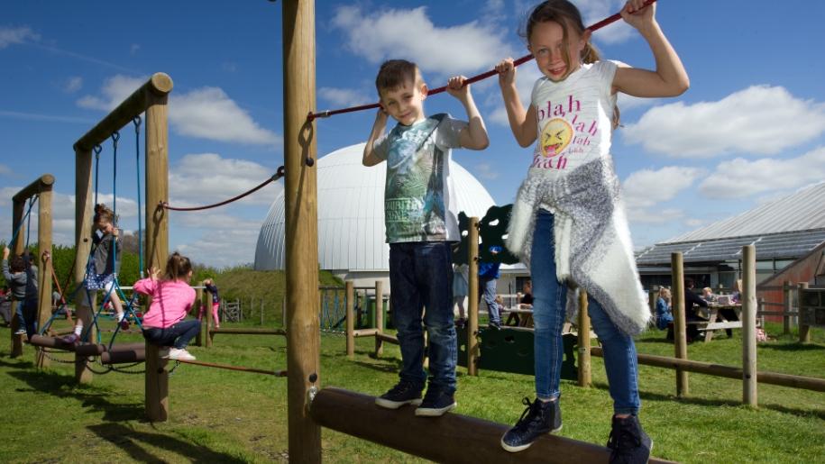 children on outdoor climbing frame