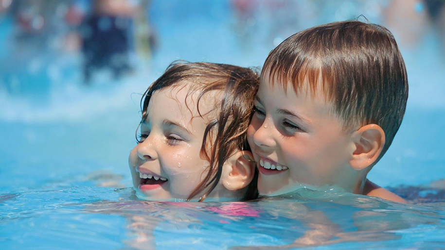 children swimming outdoos