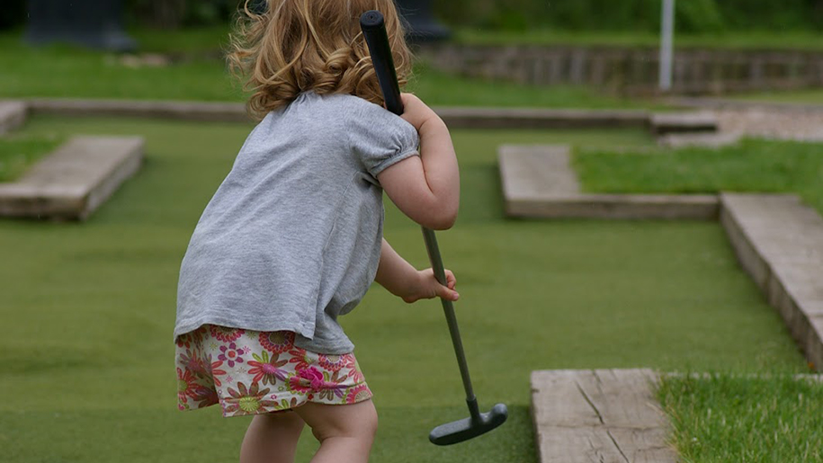 girl on miniature golf course